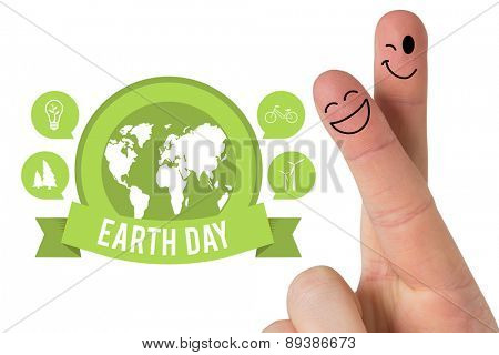 Fingers smiling against earth day graphic