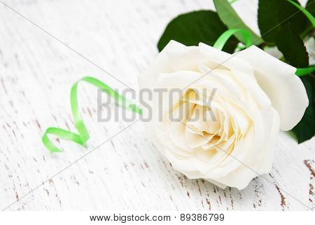 White Rose  On The Wooden Table