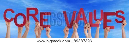 People Hands Holding Red Word Core Values Blue Sky