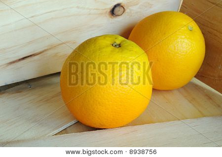 Oranges in wooden carton