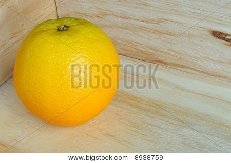 Orange in wooden carton