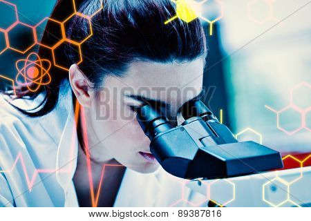 Young scientist using a microscope against science and medical graphic