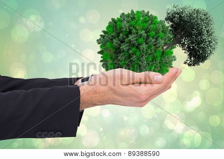 Businessman with arms out presenting something against green abstract light spot design