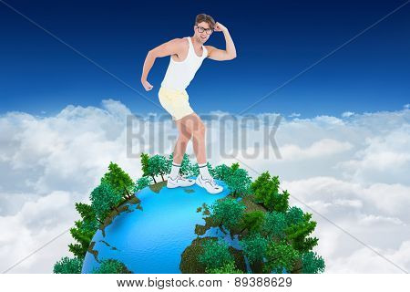 Geeky hipster posing in sportswear against bright blue sky over clouds