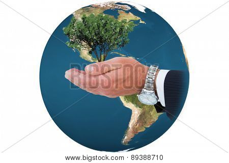 Businessman in suit offering handshake against tree with green leaves growing