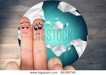 Sad fingers against bleached wooden planks background