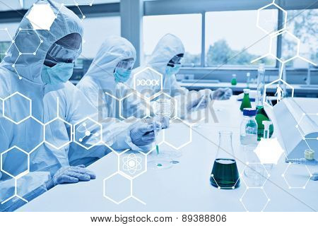 Science graphic against three chemists working in protective suits