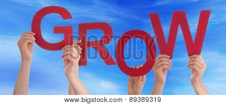 Many People Hands Holding Red Word Grow Blue Sky