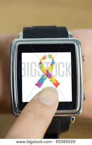 Businesswoman with smart watch on wrist against autism awareness ribbon