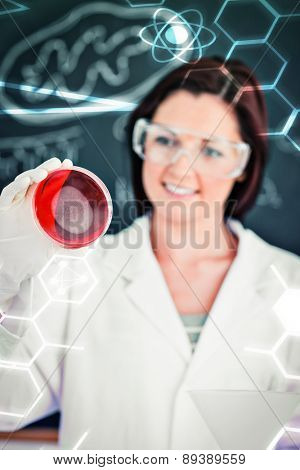 Science and medical graphic against portrait of a redhaired scientist looking at a petri dish