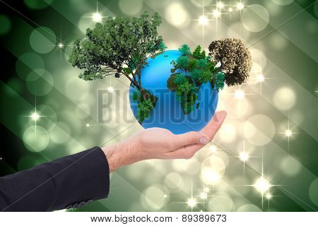 Close up of businessman with empty hand open against light design shimmering on green