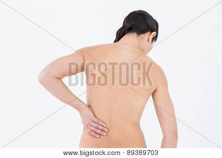 Brunette with backache on white background