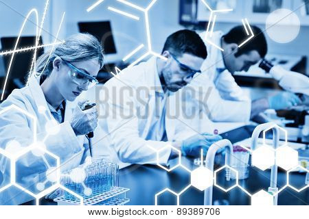 Science graphic against science students working with chemicals in lab