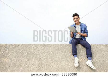 Happy Man Using Digital Tablet