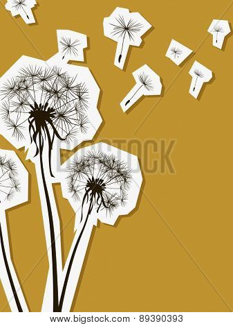silhouette of dandelion in the wind