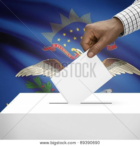 Voting Concept - Ballot Box With Us State Flag On Background - North Dakota