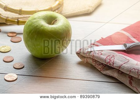 Still Life With Green Apple, Some Cent Coins And A Knife On A Towel
