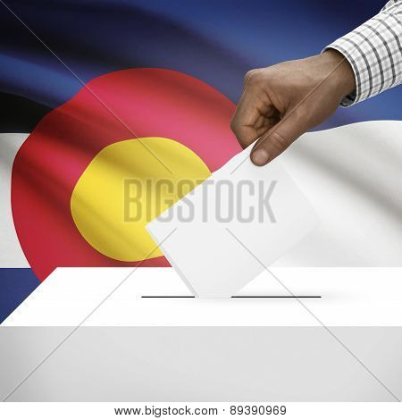 Voting Concept - Ballot Box With Us State Flag On Background - Colorado