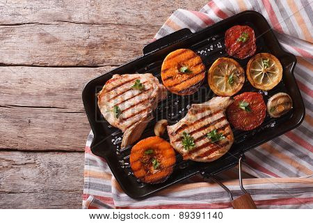 Grilled Pork And Pumpkin On A Grill Pan. Horizontal Top View
