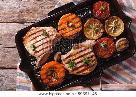 Pork And Pumpkin On A Grill Pan. Horizontal Top View Closeup