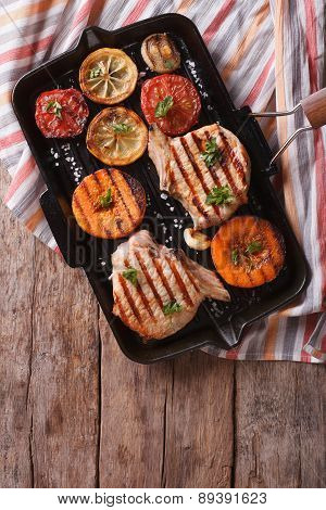 Grilled Pork And Pumpkin On A Grill Pan. Vertical Top View