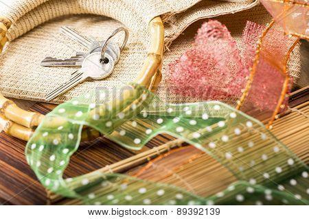 House Keys, Bamboo Handles Of A Shopping Bag And Gift Ribbons