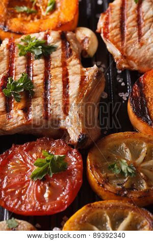 Grilled Pork Steak And Vegetables On The Grill. Vertical Macro