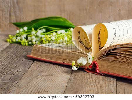Book Pages Folded Into A Heart And A Flower Lily Of The Valley