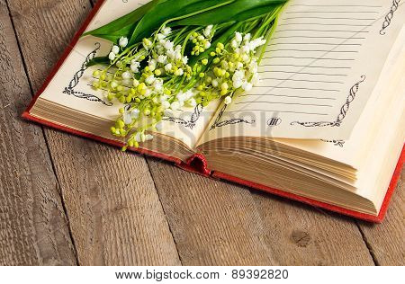 Lily Of The Valley Flowers On The Book
