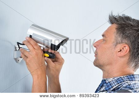 Technician Adjusting Cctv Camera