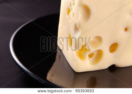 Cheese on the black plate