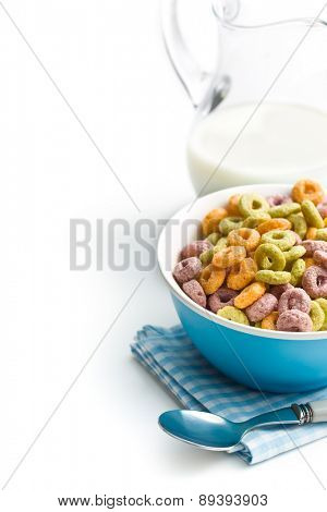 colorful cereal rings with milk on white background