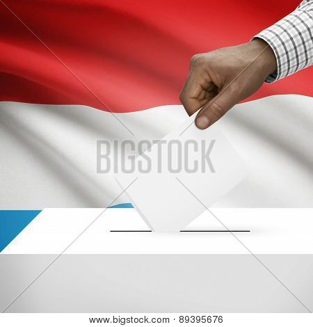 Ballot Box With National Flag On Background - Luxembourg