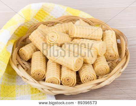 Heap Of Wafer Rolls In Basket And Towel