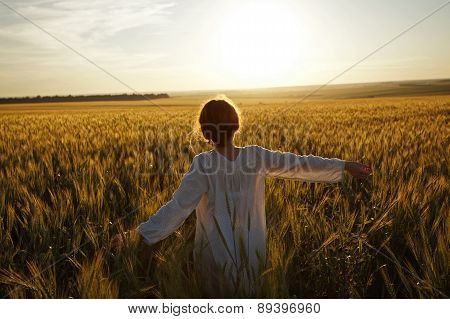 Woman In A Field Of Ripe Wheat
