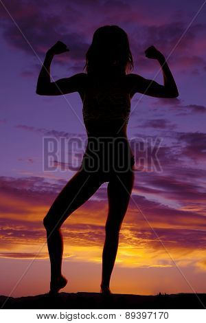 Silhouette Of A Woman In A Bikini Flexing
