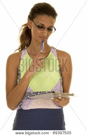 Woman Green And Blue Business Dress Look At Clipboard