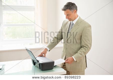 Businessman Using Photocopy Machine