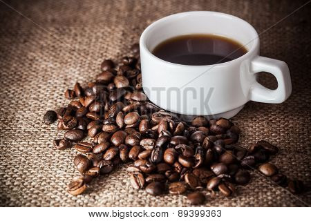 Coffee Cup On Coffee Beans