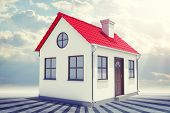 image of red roof  - Small house with red roof on abstract grey sky background - JPG