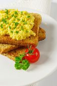 foto of tomato sandwich  - part view of roasted sandwich with egg spread and tomato - JPG