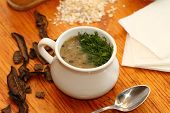 image of porridge  - dried mushrooms and porridge soup in a porcelain pot - JPG