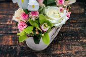 foto of vase flowers  - Flowers bouquet decoration in vintage vase on wooden table - JPG