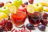 stock photo of pomegranate  - Fresh fruit juice with pomegranates and plumes - JPG