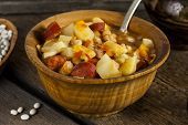 picture of hungarian  - Hungarian goulash with beans and peppers on wooden board - JPG