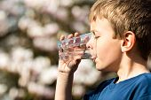 image of environmental protection  - Young boy drinking from glass of fresh water - JPG