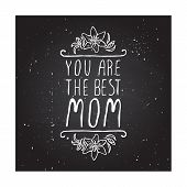 stock photo of day-lilies  - Happy mothers day card with lily flowers and handlettering element on chalkboard background - JPG