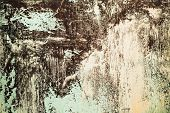 foto of rusty-spotted  - Rusty metal textured background with a light cracked paint - JPG