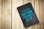 stock photo of autism  - Autism awareness day against overhead of tablet on desk - JPG