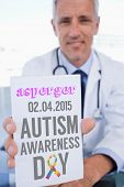 picture of prescription pad  - The word asperger and portrait of a male doctor showing a blank prescription sheet against autism awareness day - JPG